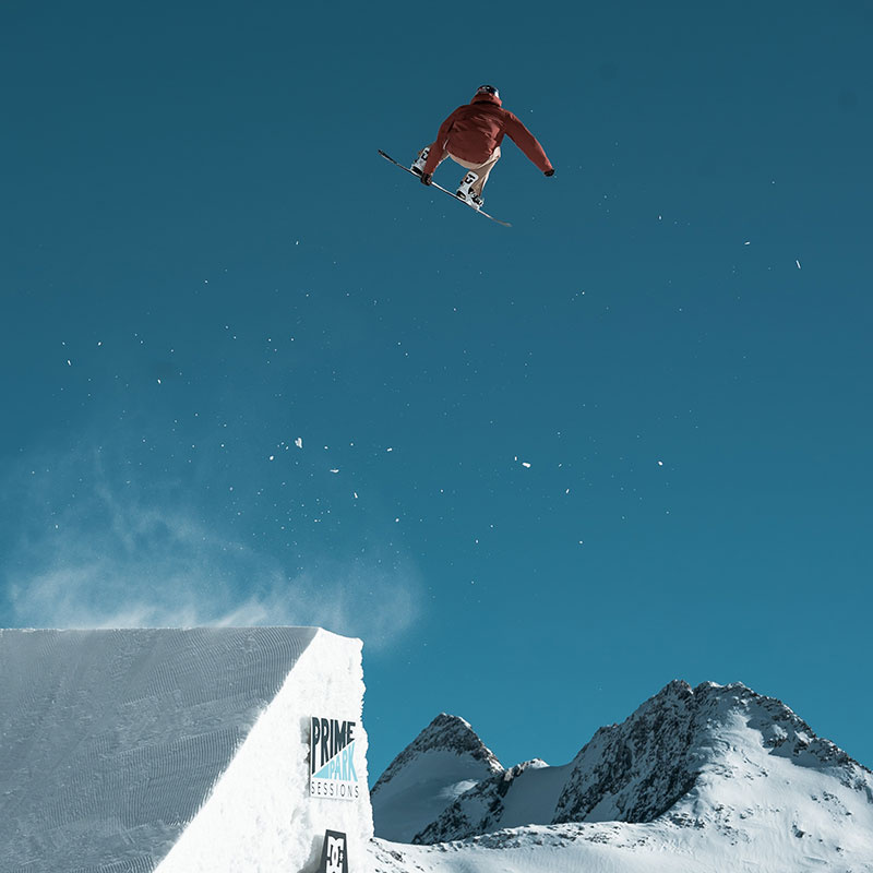 Snowboarder jumps over Ramp